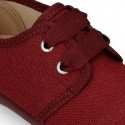 New little laces up shoes in cotton canvas to dress.