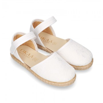 White canvas espadrille shoes with LACES design and velcro strap closure.