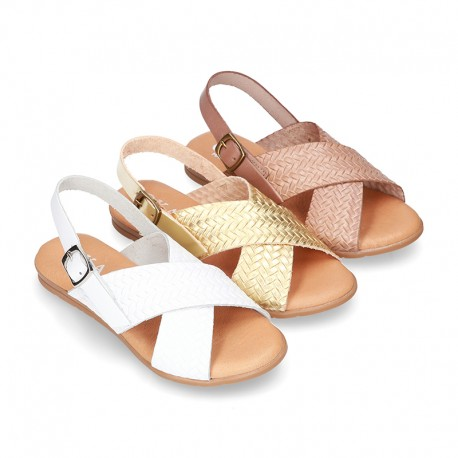ENGRAVED design Leather sandal shoes with crossed straps.