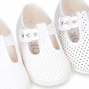Cotton canvas T-Strap shoes with blue polka dots design.