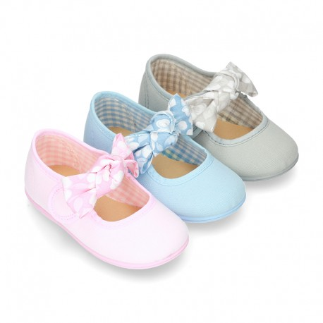 Cotton canvas little Mary Janes with velcro strap and big bow with FLOWERS design.