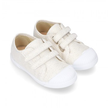 Canvas sneakers with metal finish and toe cap with VELCRO strap closure.