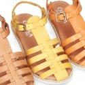 Cowhide leather sandal shoes caged type design with white soles.