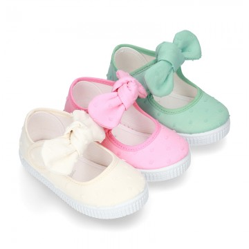 PLUMETI Cotton canvas Little Mary Janes with velcro strap and bow in pastel colors.