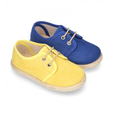 New Serratex canvas Laces up shoes espadrille style in seasonal colors.