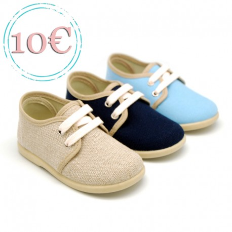 Linen canvas laces up shoes for kids.