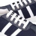 Nueva Zapatilla Primavera-Verano con cordones y rayas laterales en piel lavable combinada con lona rejilla.