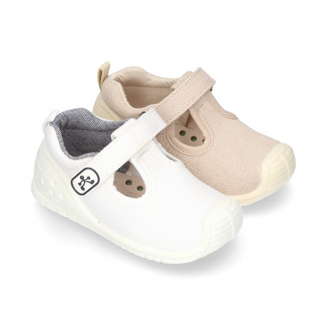 New Cotton canvas little T-Strap shoes with velcro strap design and reinforced toe cap and counter for first steps.