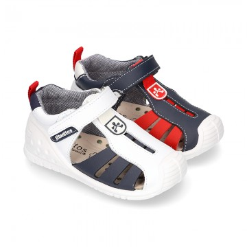 New Washable leather Tennis shoes Sandal style with velcro strap with reinforced toe cap and counter for first steps.
