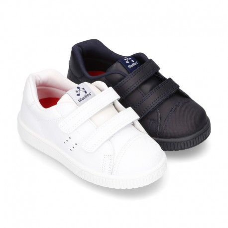 Washable Nappa leather sporty shoes with dual velcro strap and reinforced toe cap.