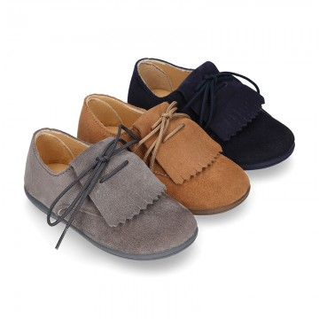 Suede leather Laces up style shoes with FRINGED design.