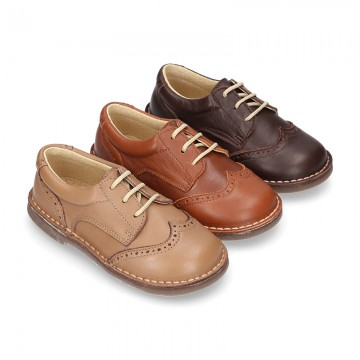 EXTRA SOFT leather Laces up shoes with perforated design.