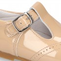 Classic little patent leather T-strap shoes in soft colors.