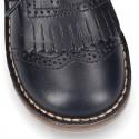 Zapatito tipo blucher con lengüeta con flecos y picados en piel VINTAGE.