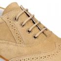 Zapato de vestir tipo blucher con picados en PIEL serraje.