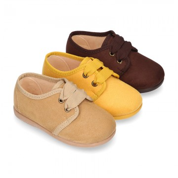 New Autumn winter canvas laces up shoes with ties closure in seasonal colors.
