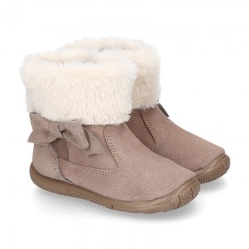 Suede leather boot shoes with ribbon and fake hair neck design for girls.