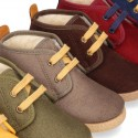 Autumn winter canvas casual ankle boots with fake hair lining.