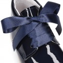 Classic patent leather ankle boots to dress with SILK ties closure for first steps.