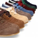 Classic perforated kids Suede leather Lace-up oxford shoes.