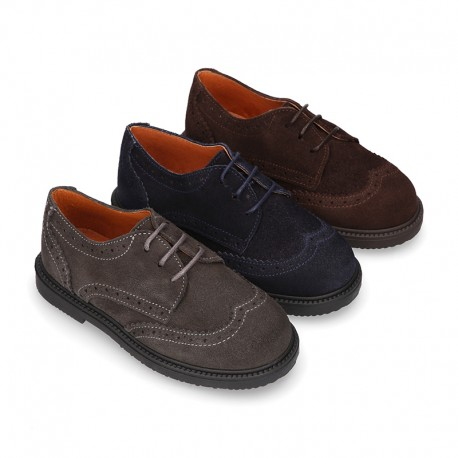 New Suede leather Oxford shoes with shoelaces closure and perforated design for kids.