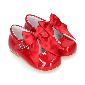 Classic RED patent leather little Mary Janes with scallop and buckle with BOW design.