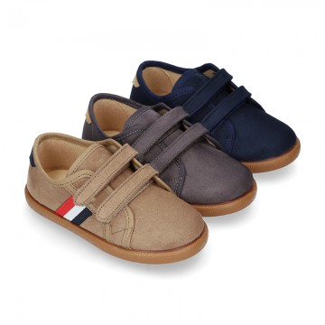 New autumn winter canvas tennis style shoes with flag detail and VELCRO strap.