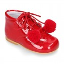 Classic RED patent leather English style bootie for first steps with POMPONS.