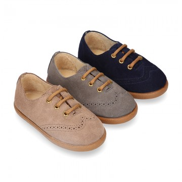 Suede leather kids Laces up style shoes with perforated design.