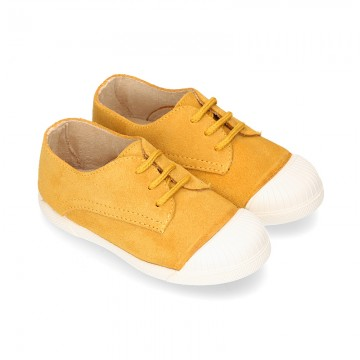 New kids MUSTARD suede leather Tennis type shoes with toe cap.