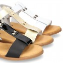 Combined leather sandals with patent and metal details finish.