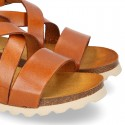 Soft Cowhide sandal shoes with white soles.