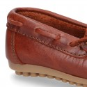 Tanned leather Moccasin shoes with bows.