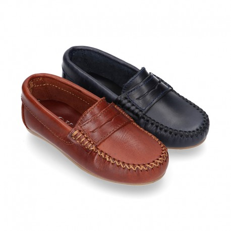 Classic Tanned leather Moccasin shoes with detail mask.