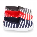 Cotton cavas Sneaker or bamba style shoes with stripes design.