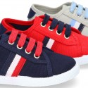 New cotton canvas tennis shoes with flag detail.