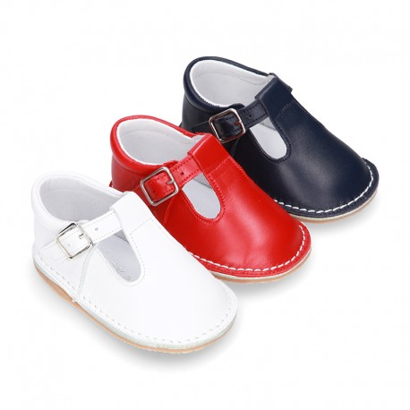 Baby Nappa leather T-bar shoes with buckle fastening and flexible soles .