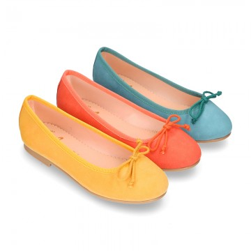 Soft Suede leather ballet flats with adjustable ribbon.