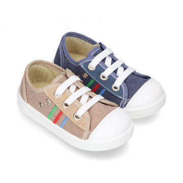 Cotton canvas sneakers with zipper and ties closure and toe cap.