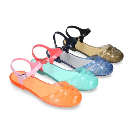 Sandal or ballet flat style jelly shoes with buckle fastening.