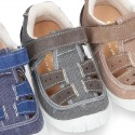 Combined T-Strap sandal shoes with hook and loop strap, toe cap and counter.