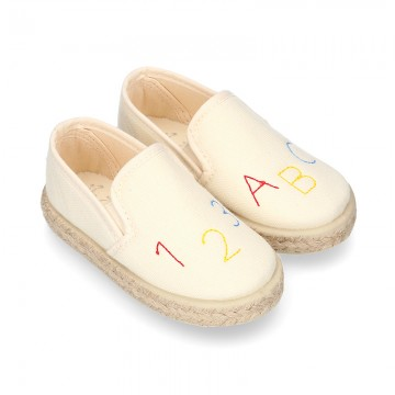 Cotton canvas kids SLIP ON Espadrille shoes with numbers and letters design and with elastic bands.