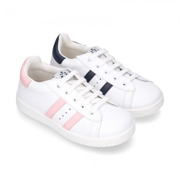 Washable leather school tennis shoes with shoelaces and stripes design.