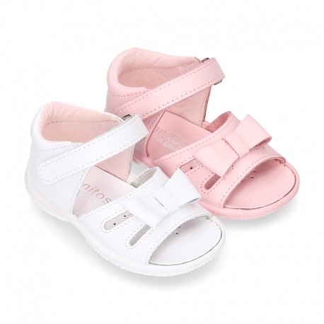 Washable leather sandals with big bow and hook and loop strap for little girls.