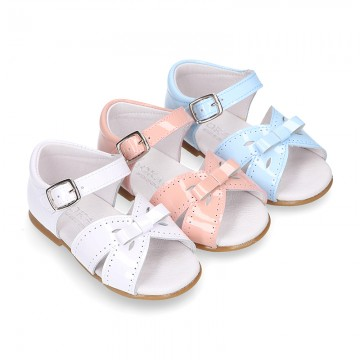 New patent leather sandals with ribbon for little girls.
