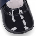 Patent leather little Mary Jane shoes with ties closure for babies.