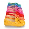 Suede leather Moccasin shoes with bows and driver type Outsole for little kids.