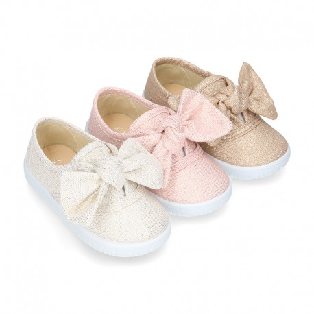 Metal canvas Bamba shoes with sweet BOW design.