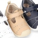 Washable leather little T-Strap shoes sandal style with hook and loop strap reinforced toe cap and counter for first steps.