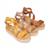 Cowhide leather sandal shoes espadrille style with braided design and buckle closure to the ankle.